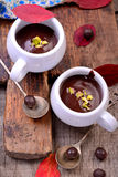 Flavored hot chocolate in small ceramic chashkahna Royalty Free Stock Photos
