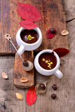 Flavored hot chocolate in small ceramic chashkahna Royalty Free Stock Image