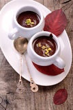 Flavored hot chocolate in small ceramic chashkahna Stock Image