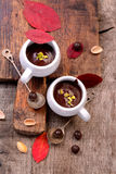 Flavored hot chocolate in small ceramic chashkahna Stock Images
