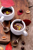 Flavored hot chocolate in small ceramic chashkahna Stock Photos