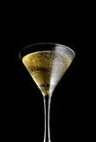 Flavored martini glass on a black background Stock Image