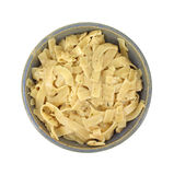 Flavored pasta noodles in bowl Stock Photo
