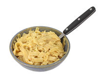 Flavored pasta noodles in bowl with fork Stock Photography