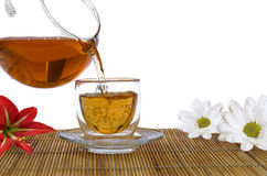 Flavored tea and flowers - aromatherapy funds Stock Image