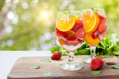 Flavored water with fresh strawberries . Royalty Free Stock Photo