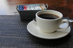 Flavorful cup of coffee on placemat Royalty Free Stock Images