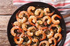 Flavorful food: shrimp in garlic sauce with parmesan cheese and. Herbs closeup on the table. horizontal view from above Royalty Free Stock Photos