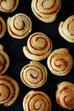 Flavorful and hot cinnamon rolls Stock Photos