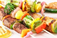 Flavorful plate of skewers. Plate full of assorted skewers  ,vegetable skewers and meat skewers Royalty Free Stock Photography