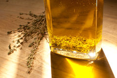 Flavoring olive oil with herbs. In bottle Stock Photos