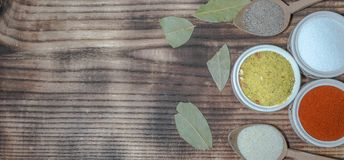 Flavorings in bowls and charcoal broken leafs royalty free stock photo