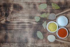 Flavorings in bowls and charcoal leafs royalty free stock photography
