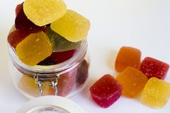 Candy jar full of colored candy,. Flavors of fruits and colors candy jar Candy jar full of colored candy stock photo