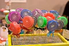 Flavors lollipops. Of different colors for children in a spiral shape Stock Photography