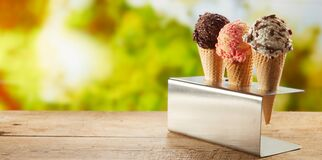 Free Flavors Of Ice Cream In Cones On An Outdoor Table Stock Photography - 178643322