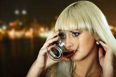 Flavour of night. Beauty blond girl with wine on night city background Royalty Free Stock Images