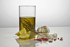 Flavoured olive oil. Oliveoil flavoured with rosemary and lemon Royalty Free Stock Image