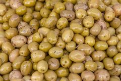 Flavoured olives closeup. Closeup shot showing lots of flavoured olives royalty free stock image