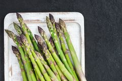 Flavoursome, sweet and tender British asparagus. Fresh and raw springtime vegetable Royalty Free Stock Photos