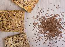 Flax biscuit. Healthy snacks, flaxseed pumpkin seeds, coriander, sunflower seeds. Salted diets are crispy crackers. Whole meal royalty free stock image