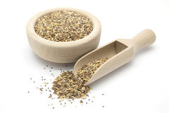 Flax, chia and sesame seeds in wooden scoop and bowl Stock Photo