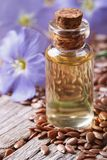 Flax oil in a bottle macro on a background of flowers and seeds Stock Images