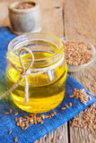 Flax oil and seeds Stock Photos