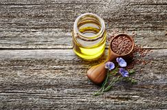 Flax oil on wooden board royalty free stock images