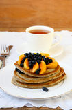 Flax pancakes with fruits Royalty Free Stock Image