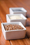 Flax, poppy and sesame seeds Royalty Free Stock Image