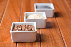 Flax, poppy and sesame seeds stock images