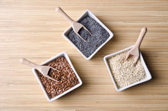 Flax, poppy and sesame seeds royalty free stock photography