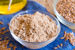 Flax powder and seeds Royalty Free Stock Photo