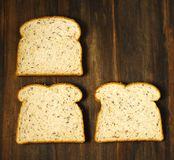 Flax and Quinoa Whole Grain Bread. Slices of Flax and Quinoa Whole Grain Bread on wooden background Stock Photography