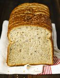 Flax and Quinoa Whole Grain Bread. On wooden table Stock Image
