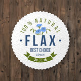 Flax round label with type design. Round label with type design and hand drawn flax on wooden background Royalty Free Stock Photography