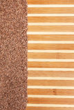 Flax seed  on a bamboo mat Royalty Free Stock Photo