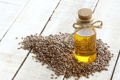 Flax seed, bottle of linseed oil, selective focus Royalty Free Stock Image