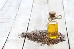 Flax seed, bottle of linseed oil Stock Photo