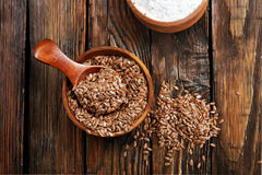 Flax seed and flour. On the wooden table Stock Images