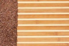 Flax seed  on a light  bamboo mat Stock Photos