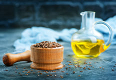 Flax seed and oil. In glass bottle royalty free stock photo