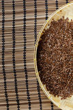 Flax seed placed on flat woven basket. Royalty Free Stock Image