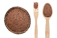 Flax seed in a plate, fork and spoon Royalty Free Stock Image