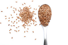 Flax seed. On a spoon Stock Images