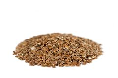 Flax Seeds. A heap of dried brown flax seeds. White background. Flax is also known as common flax or linseed (Linum usitatissimum stock photo