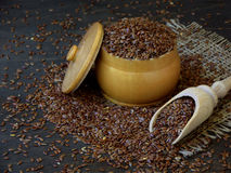 Flax seeds in a bowl and scoop. Royalty Free Stock Photos