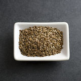 Flax seeds in bowl on the table Stock Photo