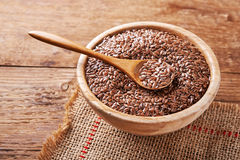 Flax seeds in bowl Stock Image